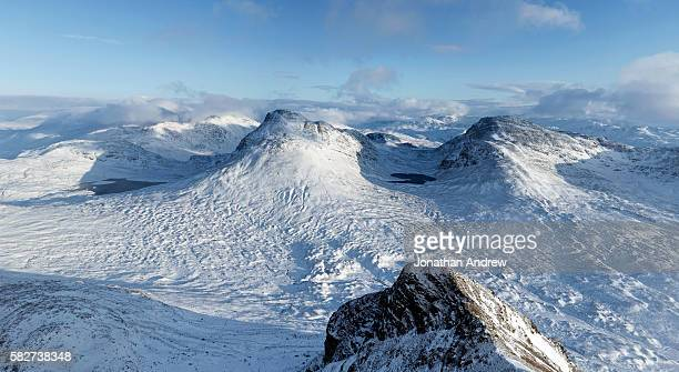 maol cheann-dearg seen from the summit of beinn damh in winter - wester ross stock pictures, royalty-free photos & images