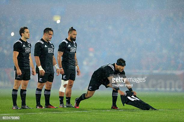 Maori All Blacks players present a shirt in memory of former Munster Coach Anthony Foley before the friendly match between Munster and Maori All...