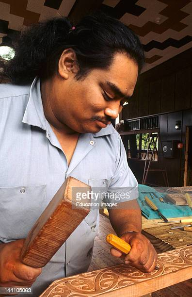 Maori Artist Carving Wood In His Studio At Rotorua New Zealand