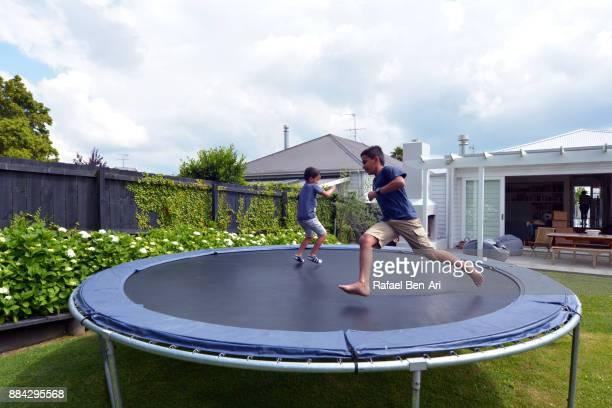 maori boys jumping on trampoline - rafael ben ari photos et images de collection
