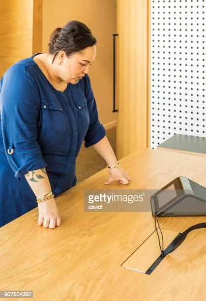 Maori Businesswoman Making a Conference Call