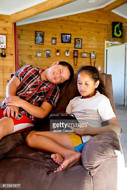 Maori children at home with tablet device