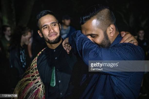 Maori community leader comforts a man as he weeps after praying near Haka near Al Noor mosque on March 20 2019 in Christchurch New Zealand 50 people...