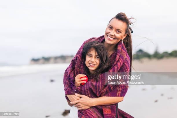 Maori family at beach.