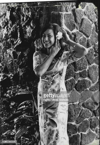 Maori hostess Lillian Nathan 23 of New Zealand one of the three beautiful Polynesian lasses of the American Club's Polynesian Room stands in front of...