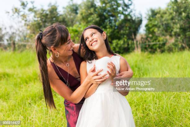Maori mother and daughter showing care for each other.