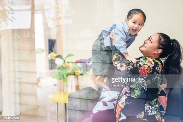Maori mother with her kid.
