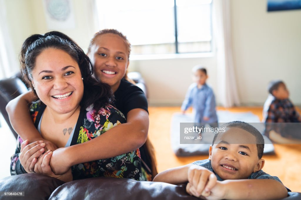 Maori mother with kids at home. : Stock Photo