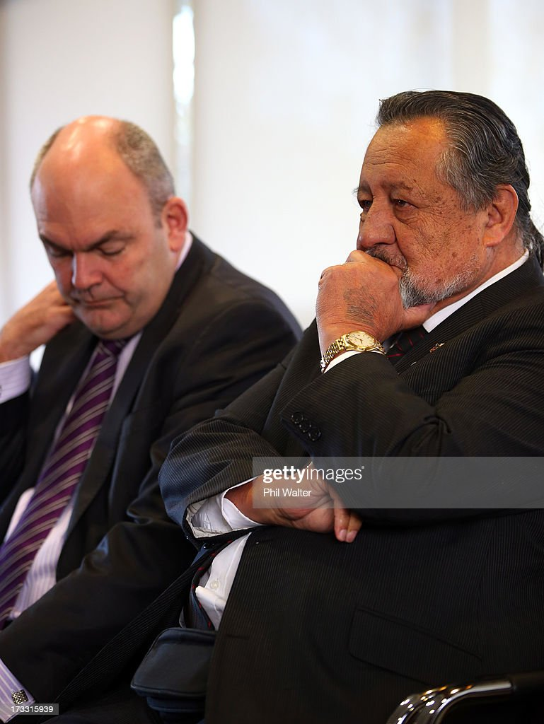 Maori Party co-leader Pita Sharples (R) and Tertiary Education, Skills and Employment Minister Steven Joyce (L) look on as Prime Minister John Key speaks at the Auckland University of Technology's Manukau Campus on July 12, 2013 in Auckland, New Zealand. The Government today announced a major expansion to the Manukau Campus, which will see the number of full time students increase from the current 940 to 4100 by 2020.
