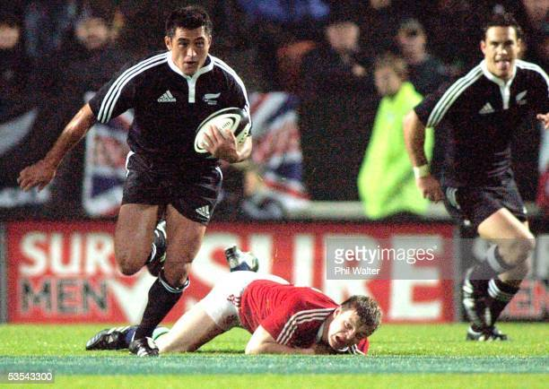 Maori Rua Tipoki steps throuigh the tackle of British and Irish Lions Brian O'Driscoll in their International Rugby match played at Waikato Stadium...