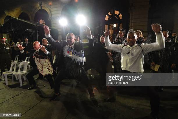 Maori servicemen perform traditional Haka at the Anzac Day dawn service in Sydney on April 25, 2021. - Dawn services were held across the two...