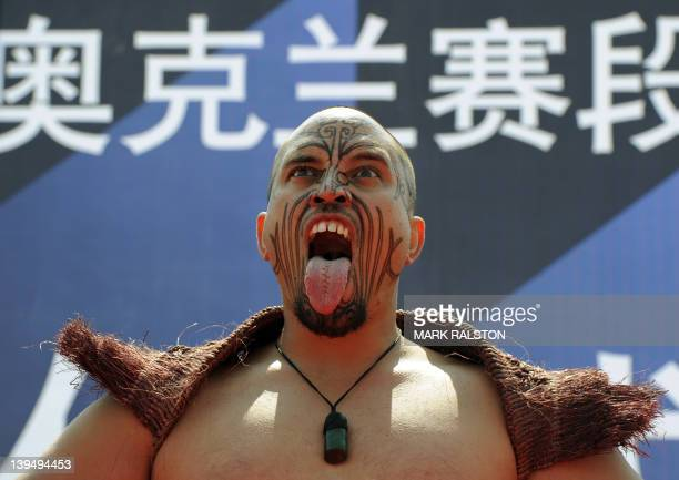 A Maori warrior from New Zealand performs at the departure ceremony before the stage one start of Leg 4 to Auckland in the Volvo Ocean Race at Sanya...