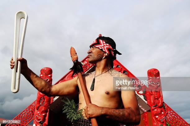 Maori warrior holds the Commonwealth Games Queen's baton during the Commonwealth Games Queen's Baton relay function at Te Manukanuka o Hoturoa Marae...