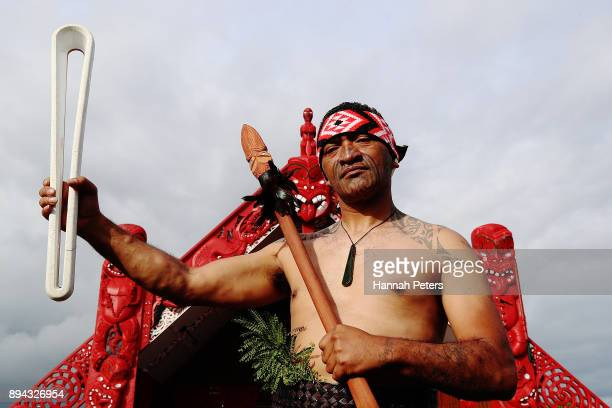 Maori warrior holds the Commonwealth Games Queen's baton during the Commonwealth Games Queen's Baton relay function at Te Manukanuka o Hoturoa Marae...