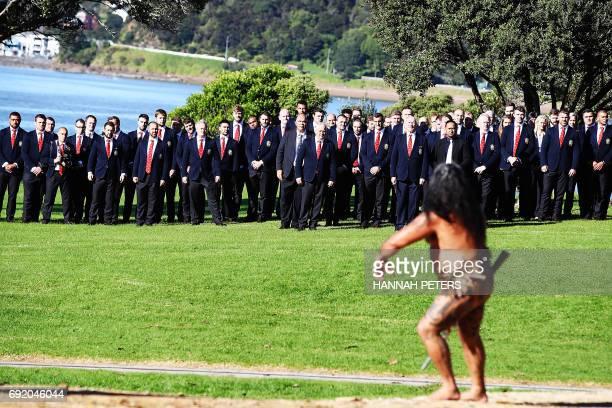 A Maori warrior leads the British and Irish Lions team up to the Waitangi Treaty Grounds during a Maori welcoming ceremony at the Waitangi Treaty...