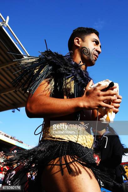 Maori warrior leads the team out for the round nine NRL match between the New Zealand Warriors and the Sydney Roosters at Mt Smart Stadium on April...