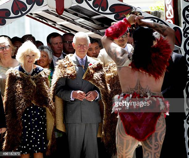 A Maori warrior perform a 'Powhiri' maori challege to welcome Britain's Prince Charles and his wife Camilla Duchess of Cornwall during a visit to...