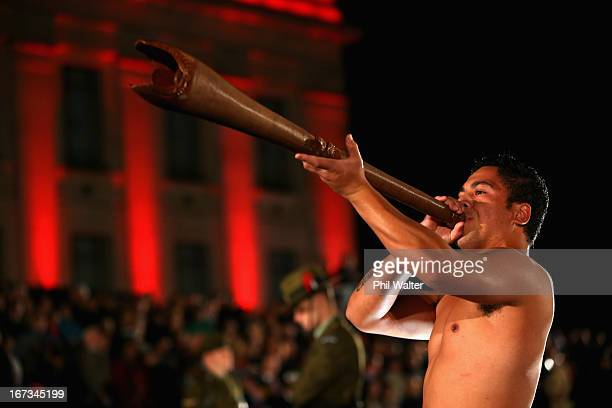 A maori warrior plays the Pukaea at the Cenotaph during the ANZAC Day Dawn Service at the Auckland War Memorial Museum on April 25 2013 in Auckland...