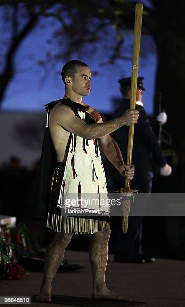 Maori warrior stands guard during the ANZAC Day Dawn Service on April 25 2010 in Dunedin New Zealand Veterans dignitaries and members of the public...
