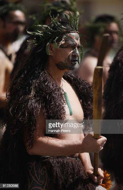 Maori Warrior waits to farewell the coffin of Sir Howard Morrison after the funeral at the Te Papaiouru Marae Ohinemutu on September 29 2009 in...