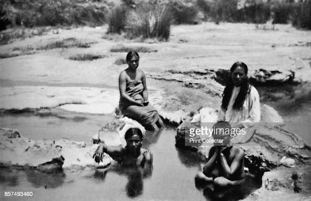 Maoris bathing in a hot pool 1902 From The Living Races of Mankind Vol I [Hutchinson Co London 1902] Artist Muir Moodie