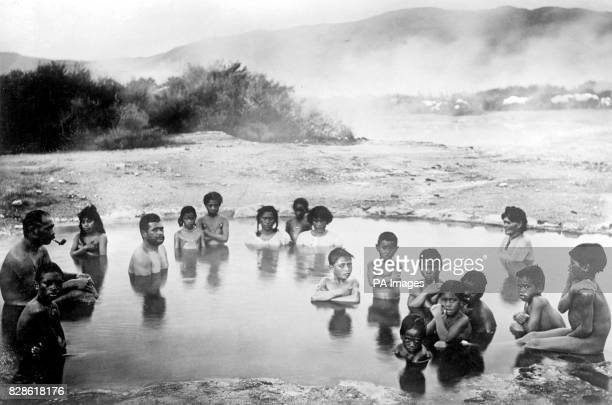 Maoris bathing in the hot springs at Korotiotio Whakarewarewa