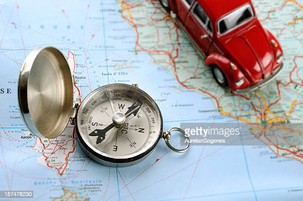 Map, compass and a small car