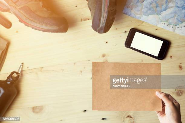 map mountain and trekking gear with smart phone on wooden background explorer