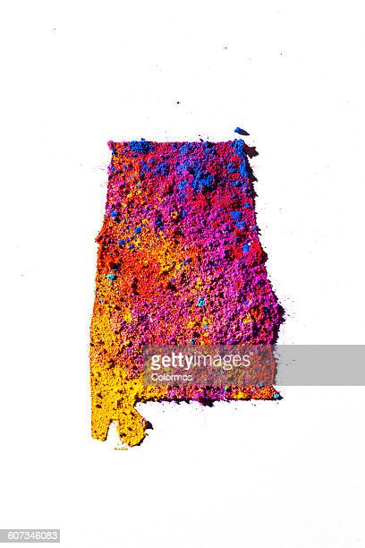 Map of Alabama, USA with colored powder
