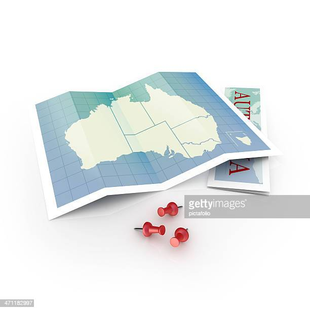 Map of Australia on white desk and pins
