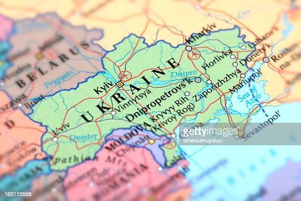 map of green ukraine on a globe - ukraine stock pictures, royalty-free photos & images