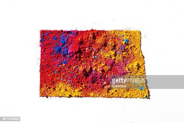 Map of North Dakota, USA with colored powder