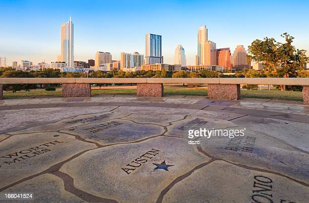 map of texas with austin skyline in background - austin texas stock pictures, royalty-free photos & images