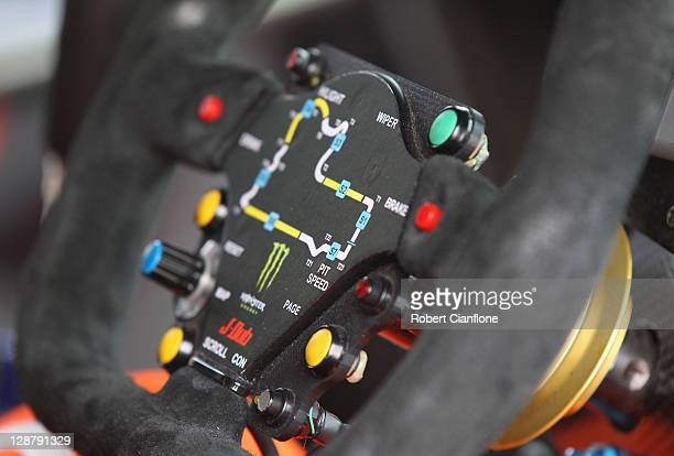 A map of the circuit is seen on the steering wheel of the Jamie Whincup Team Vodafone Holden before the warm up session prior to the Bathurst 1000...