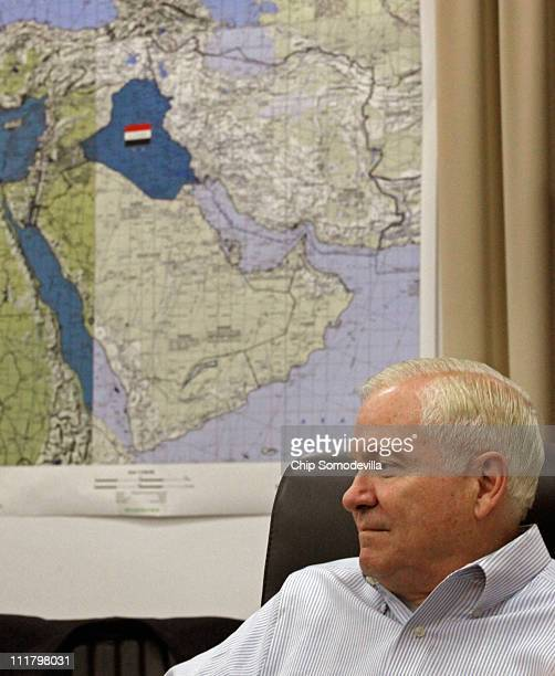 A map of the Mideast hangs behind US Defense Secretary Robert Gates while he meets with military and diplomatic leaders at the Al Faw Palace at Camp...