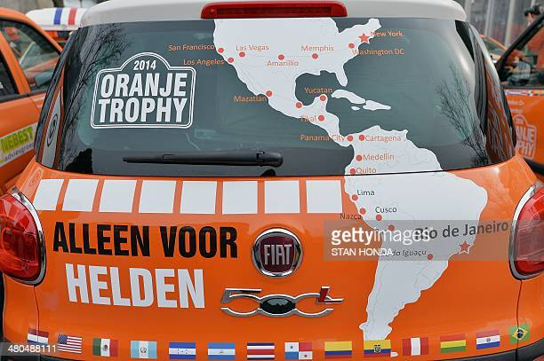"""Map of the route is seen on a car, part of a caravan of 22 orange vehicles beginning a 15,600-mile , 80-day, 14-country """"Oranje Trophy"""" tour on March..."""