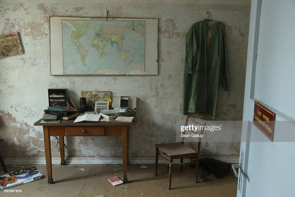 A map of the world in Russian hangs over a desk in the officers' building at the former Soviet military base on January 26, 2017 in Wuensdorf, Germany. Wuensdorf, once called 'The Forbidden City,' was the biggest base for the Soviet armed forces in communist East Germany from 1945 until the last Soviet troops left in the early 1990s following the end of the Cold War and the reunification of Germany. While Soviet troops pulled out of eastern Europe after 1989, Russian troops have in recent years intervened in Ukraine. The NATO military alliance has strengthened its presence in the Baltic states in an effort to prevent similar Russian intervention there.