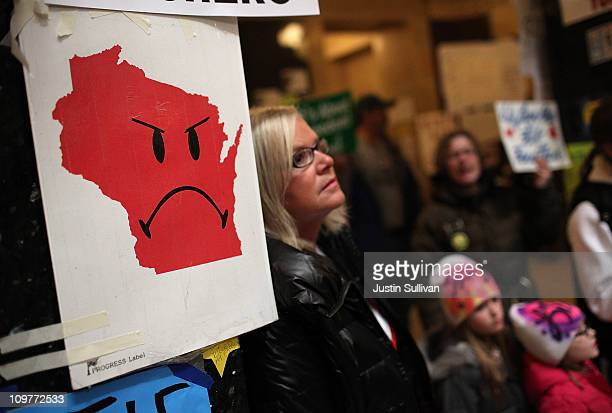 A map of Wisconsin with a sad face is taped to the wall inside the Wisconsin State Capitol on March 4 2011 in Madison Wisconsin Some demonstrators...
