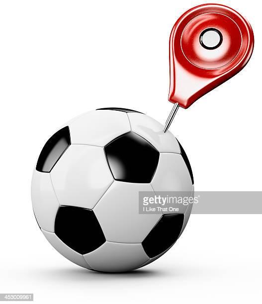 map pin / push pin stuck into a football