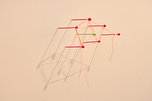 Map pins tangled with a string - gettyimageskorea