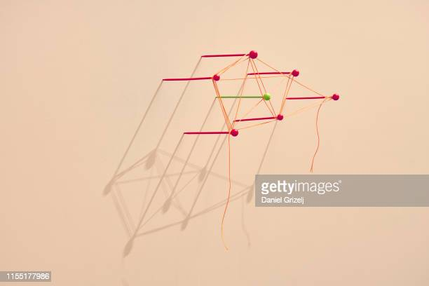 Map pins tangled with a string