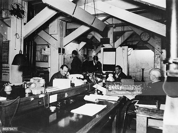 Map room officers on duty in the Cabinet War Rooms beneath Whitehall in London 2nd May 1945