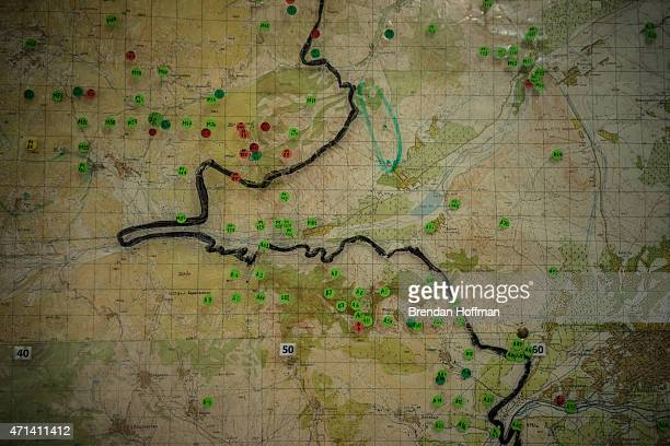 Map showing the locations of already cleared minefields, marked in green, and minefields yet to be cleared, marked in red, at the offices of the...