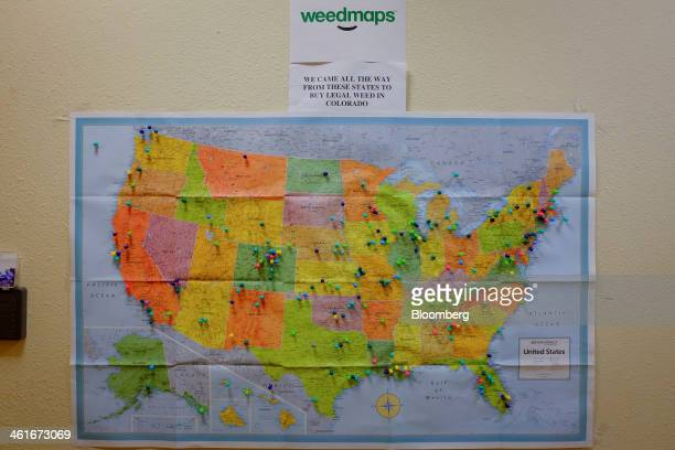 A map showing the states where customers have come from is displayed inside a hallway at a medical marijuana dispensary in Denver Colorado US on...