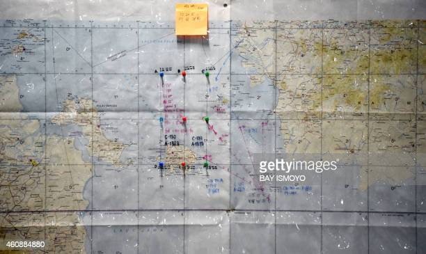 A map shows the target area which will be covered by Indonesian Air Force C130 Hercules aircraft over the Java Sea during search and rescue...