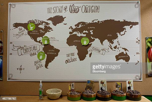 A map telling the company's story is displayed with chocolate samples and hand sanitizer at the Theo Chocolate factory in Seattle Washington US on...