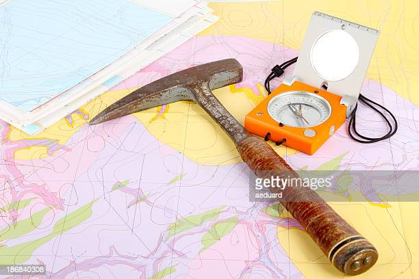 Map with compass and hammer