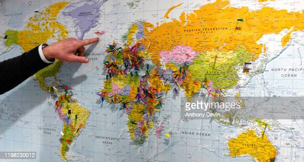 Map with pins showing the home countries of Amazon employees is displayed at the Amazon Fulfilment Centre in Altrincham on November 28, 2019 in...