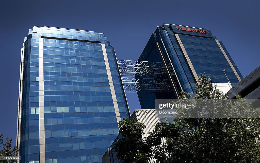 Mapfre SA signage is displayed at the top of the Euro Plaza business center in Guatemala City, Guatemala, on Wednesday, Nov. 23, 2011. Foreign direct investment in Guatemala will stagnate this year at about $668 million, after rising 22 percent in 2010, according to the International Monetary Fund (IMF). Photographer: Victor J. Blue/Bloomberg via Getty Images
