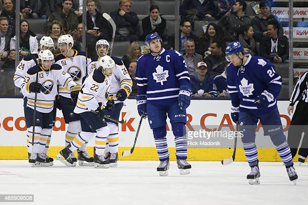 TORONTO MARCH 11 Maple Leaf Captain Dion Phaneuf and James van Riemsdyk skate away after Buffalo nets the 1st goal Toronto Maple Leafs vs Buffalo...